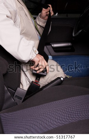 Female hand  fastening  a seat belt in the car. - stock photo