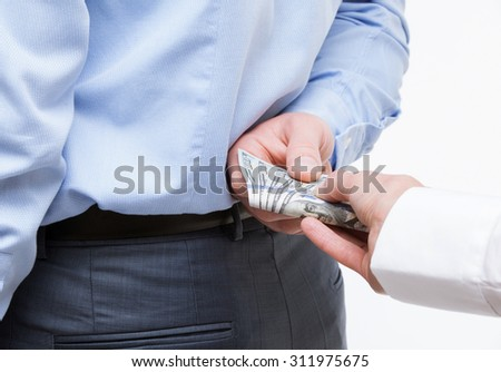 Female hand giving a bribe to businessman - closeup shot