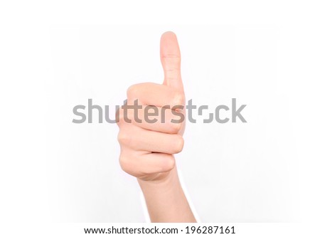 Female hand giving a thumbs up approval. Isolated on a white background.