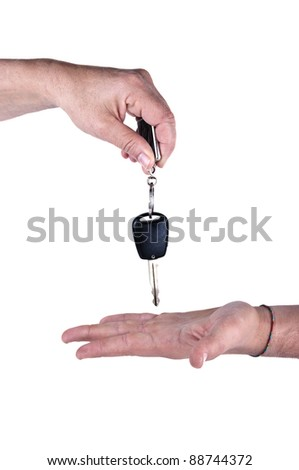 female hand giving car key to male hand on white background