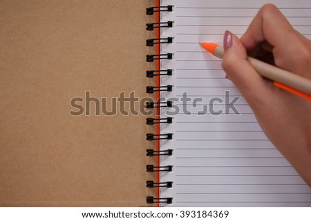 female hand hold a empty(blank) book(note, diary) spread(unfold) with pen - stock photo