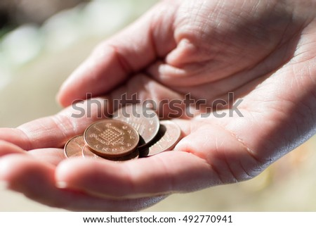 Female Hand Hold Five Pennies B UK Currency Shallow Depth of Field horizontal photography