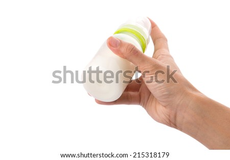 Female hand holding a baby bottle of milk over white background - stock photo