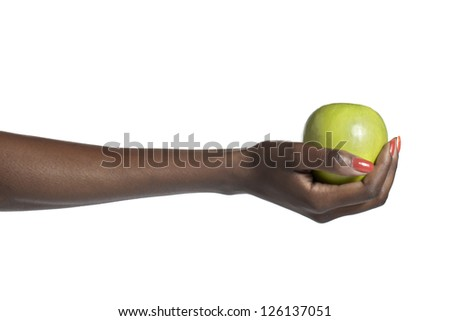 Female hand holding a green apple