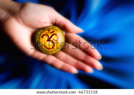 female hand holding a healing stone with mystic om letter - stock photo