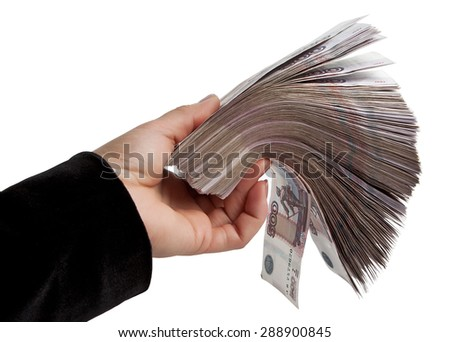 Female hand holding a large stack of paper Russian money - stock photo