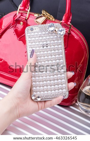 Female hand holding a phone case