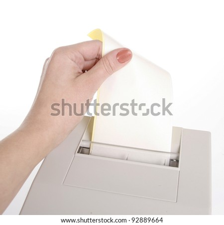 Female hand holding a receipt - stock photo