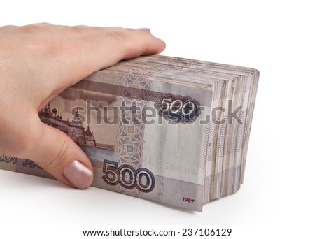 Female hand holding a stack of Russian paper money - stock photo