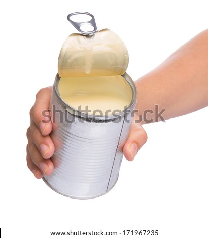 Female hand holding a tin can of condensed milk - stock photo