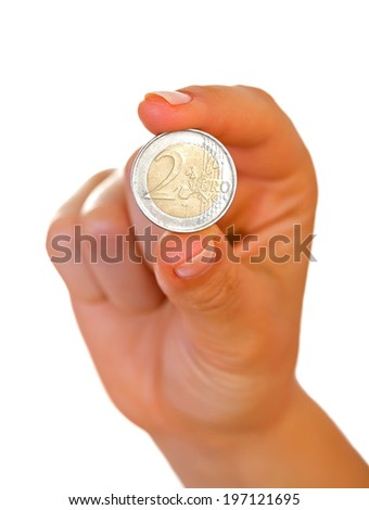 Female hand holding a two euro coin - stock photo