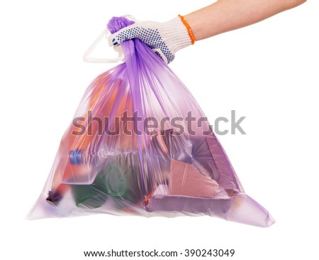 Female hand holding a waste bag isolated on white background. - stock photo