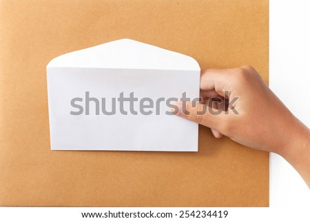Female hand holding a white envelope - stock photo