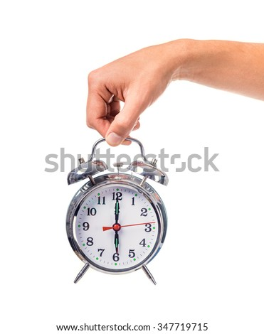 Female hand holding alarm clock, isolated on a white background - stock photo
