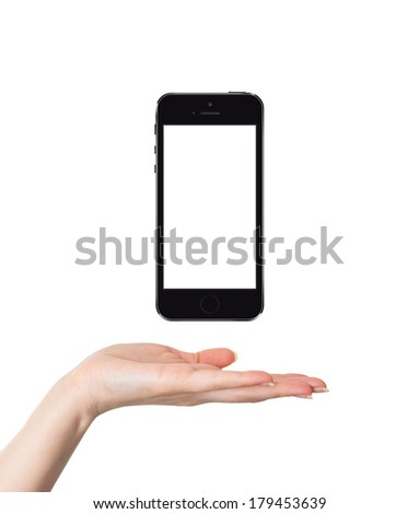 Female hand holding and showing a smart phone similar to iphon isolated on white - stock photo