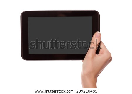 Female hand holding android digital tablet computer with black empty screen and copyspace, isolated on white background. - stock photo