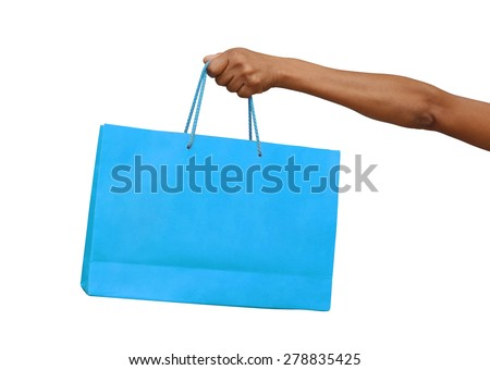 female hand holding blue shopping bag isolated - stock photo