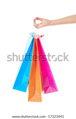 Female hand holding bright colored shopping bags, isolated on white