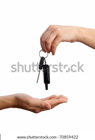Female hand holding car key and handing it over - stock photo