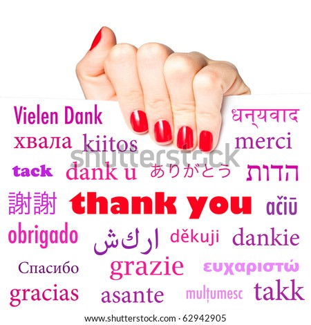 "Female hand holding card with the word ""thank you"" in many different languages - stock photo"