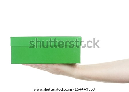 Female hand holding cardboard box isolated on white background - stock photo