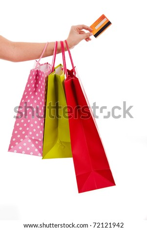 Female hand holding colorful shopping bags and a credit card - stock photo