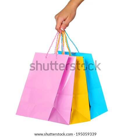 Female Hand Holding Colorful Shopping Bags isolated on white