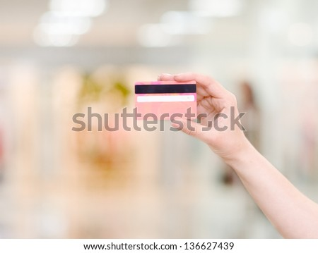 Female hand holding credit card - stock photo