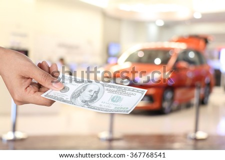 Female hand holding dollars ,concept of finance for car - stock photo