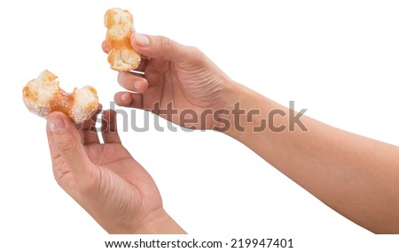 Female hand holding doughnuts over white background