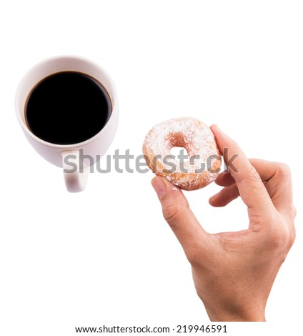 Female hand holding doughnuts with a mug of coffee over white background - stock photo