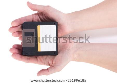 Female hand holding floppy disks on white background - stock photo