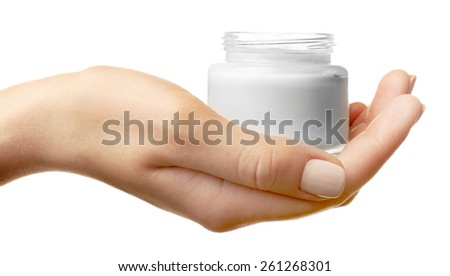 Female hand holding jar of cream isolated on white - stock photo