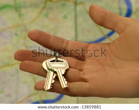 Female hand holding key in front of a Shanghai map - stock photo