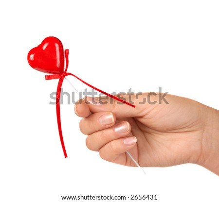 Female hand holding little red heart Valentine Day concept Isolated on white background - stock photo