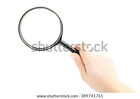 Female hand holding magnifying glass on a white background