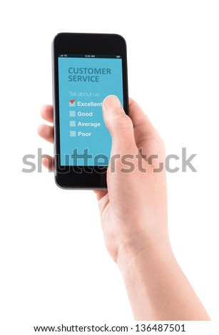 Female hand holding modern smartphone with customer service survey form on a screen. Red tick on excellent choice showing customer satisfaction. - stock photo
