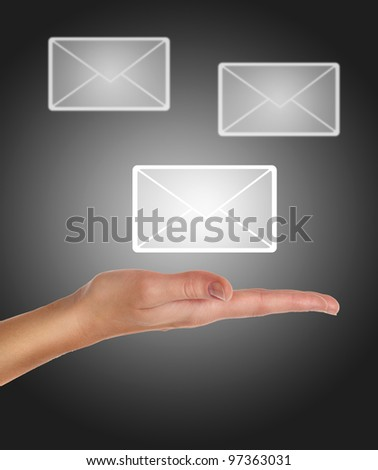 female hand holding or getting e-mail sign on a touch screen interface over black and grey background - stock photo