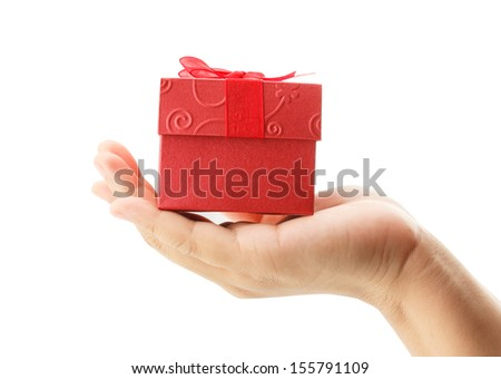 female hand holding red gift box isolated on white background - stock photo
