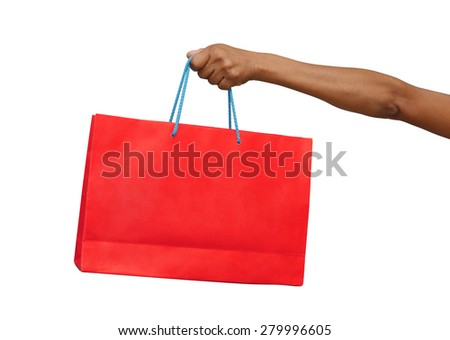 female hand holding red shopping bag isolated
