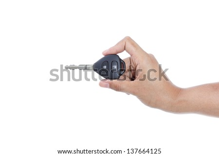 female hand holding remote control car key on white background