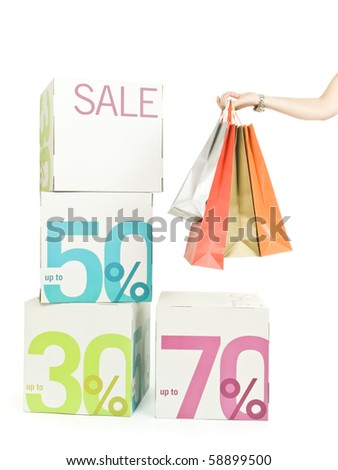 Female hand holding shopping bags - stock photo