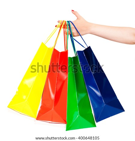 female hand holding shopping bags isolated on white - stock photo