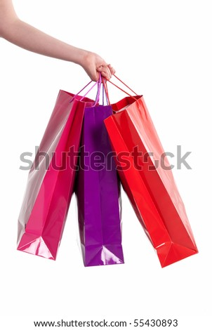Female hand holding shopping bags isolated on white background