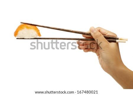female hand holding sushi sashimi asian food on white  - stock photo