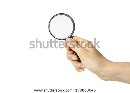 Female hand holding the magnifying glass - stock photo