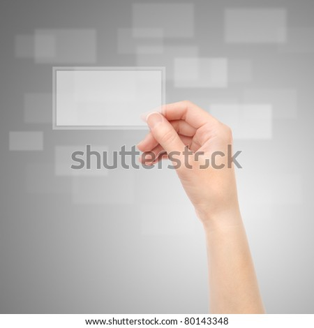 Female hand holding translucent electronic business card on a gray background.