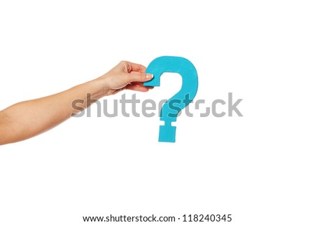 Female hand holding up a turqise question mark against a white background conceptual of questions, query, why or what. - stock photo