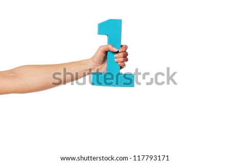Female hand holding up the number 1 against a white background conceptual of numbers, measurement, amount, quantity, accounting and mathematics