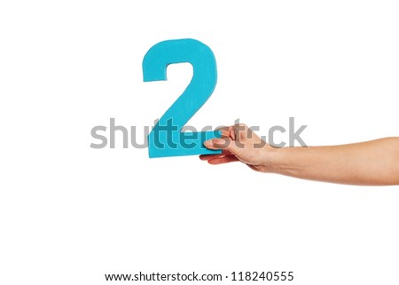 Female hand holding up the number 2 against a white background conceptual of numbers, measurement, amount, quantity, accounting and mathematics - stock photo